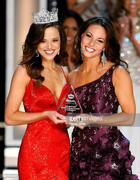 Miss America 2009 Katie R Stam presents the Lifestyle Fitness in Swimsuit award to Alyse Zwick Miss New York during a preliminary competition for the...