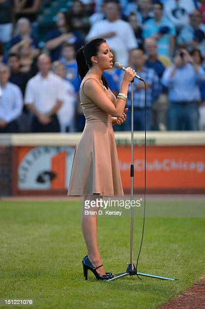 Miss America 2012 Laura Kaeppeler sings the 'Star Spangled Banner' before the Chicago Cubs Milwaukee Brewers game at Wrigley Field on August 28 2012...