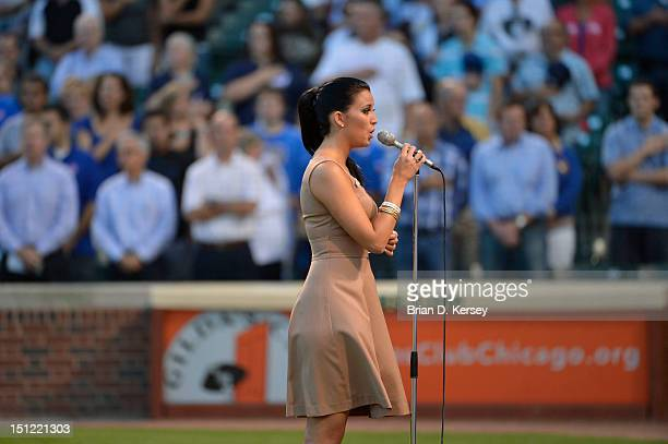 Miss America 2012 Laura Kaeppeler sings the 'Star Spangled Banner' before the game between the Milwaukee Brewers and the Chicago Cubs at Wrigley...