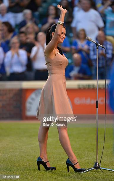 Miss America 2012 Laura Kaeppeler waves after singing the 'Star Spangled Banner' before the game between the Milwaukee Brewers and the Chicago Cubs...