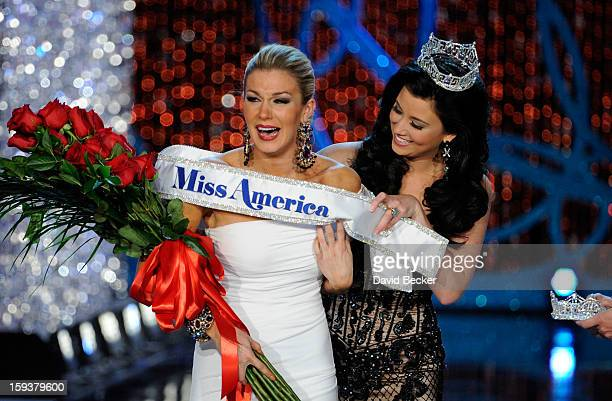 Miss America 2012 Laura Kaeppeler wraps the sash around Mallory Hytes Hagan of New York the new Miss America during the 2013 Miss America Pageant at...
