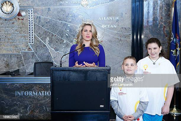 Miss America 2013 Mallory Hagan and Bryce and Molly of the Childrends Miracle Network Hospitals light The Empire State Building on May 29 2013 in New...