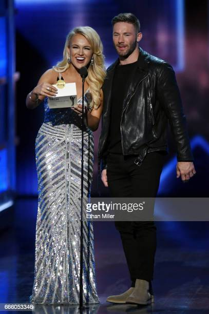 Miss America 2017 Savvy Shields and wide receiver Julian Edelman of the New England Patriots present the award for Female Vocalist of the Year during...