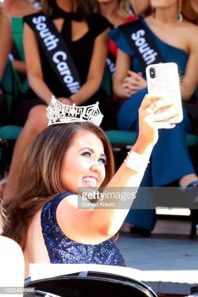 Miss America 2018 Cara Mund videos the opening ceremony at Kennedy Plaza on August 30 2018 in Atlantic City New Jersey