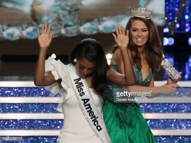 Miss America 2019 Nia Franklin is crowned by Miss America 2018 Cara Mund during the 2019 Miss America Pageant at Atlantic City Boardwalk Hall on...