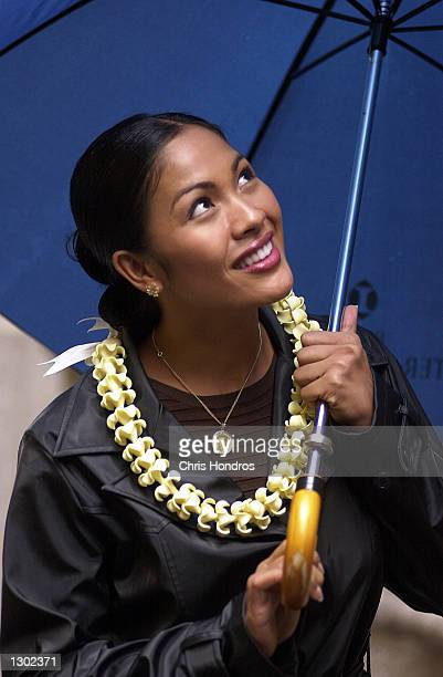 Miss America Angela Perez Baraquio looks out from under an umbrella October 16 2000 in New York Baraquio was chosen Miss America 2001 in Atlantic...