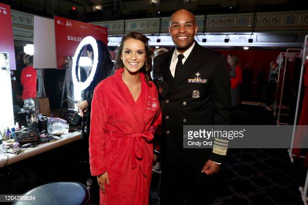 Miss America Camille Schrier and Jerome Adams prepare backstage at The American Heart Association's Go Red for Women Red Dress Collection 2020 at...