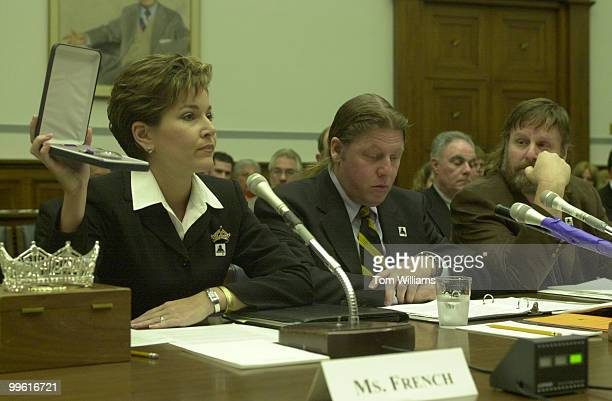 Miss America Heather French daughter of a disabled Vietnam Vet displays a Purple Heart and speaks before a Subcommitte on the awareness of Hepatitis...
