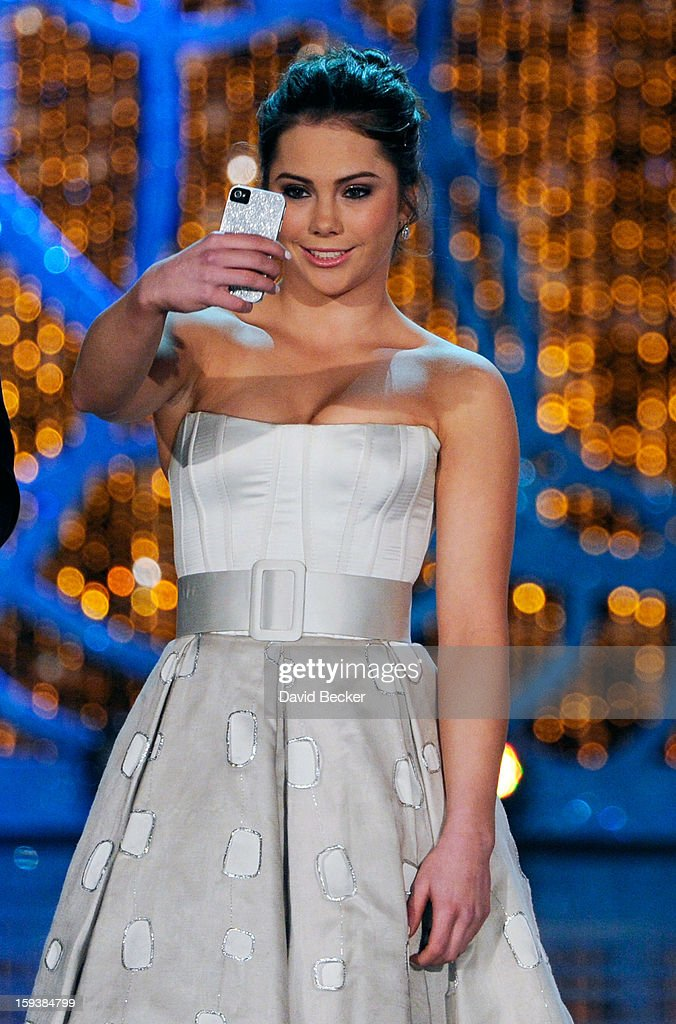 Miss America judge McKayla Maroney photographs herself onstage before the 2013 Miss America Pageant at PH Live at Planet Hollywood Resort & Casino on January 12, 2013 in Las Vegas, Nevada.
