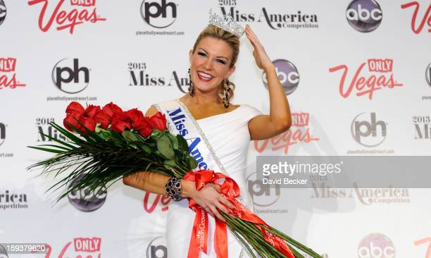 Miss America Mallory Hytes Hagan of New York poses during a news conference after she was crowned during the 2013 Miss America Pageant at Planet...