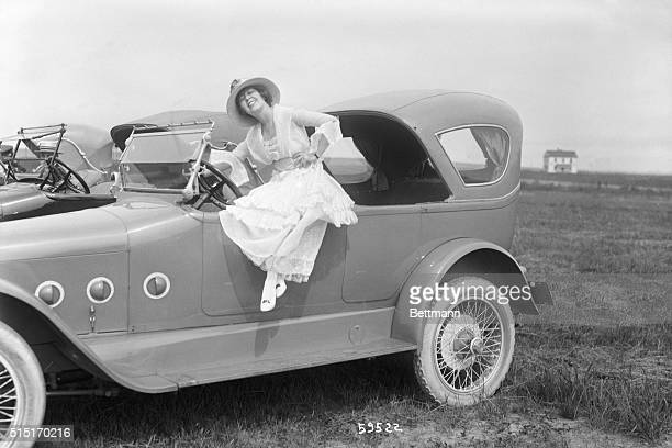 6/23/1917AT THE MOVIE FASHION AUTO SHOW Miss Ann Pennington in a Chalmers Car and wearing a gown by Grael