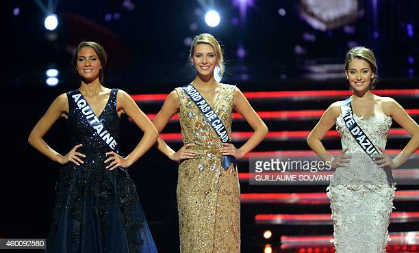 Miss Aquitaine 2014 Malaurie Eugenie Miss NordPasdeCalais Camille Cerf and Miss Cote d'Azur 2014 Charlotte Pirroni pose during the Miss France 2015...
