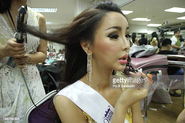 Miss Arisa from South Korea prepares and makes up backstage for the transvestite and transgender beauty pageant Miss International Queen 2013 at...
