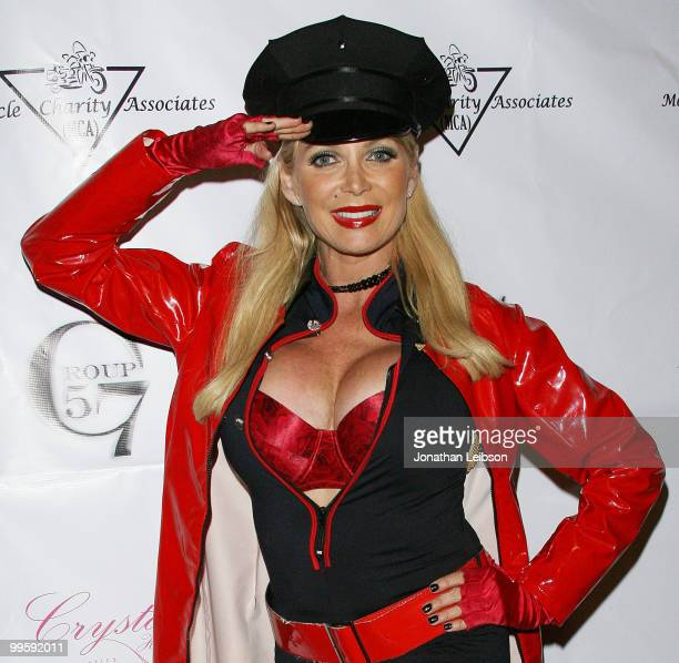 Miss Armed Forces Shelley Michelle arrives to the Stars And Stripes At The Playboy Mansion on May 15 2010 in Los Angeles California