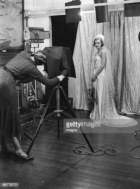 Miss Audrey Barrett an American girl gets photographed in a photo studio in London Photograph 18th of May 1931