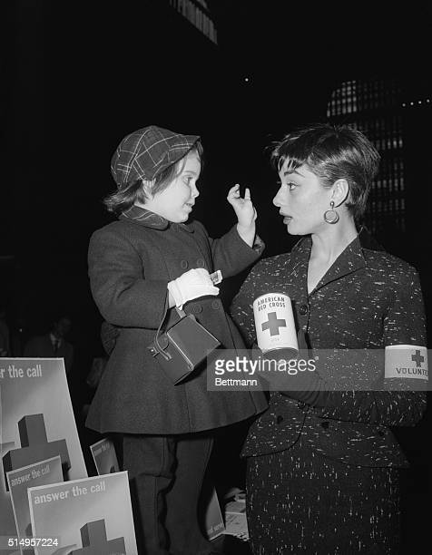 Miss Audrey Hepburn star of the current Broadway play Ondine holds a quick conference with Peggy Ann Malone the three year old daughter of Mr and Mrs...