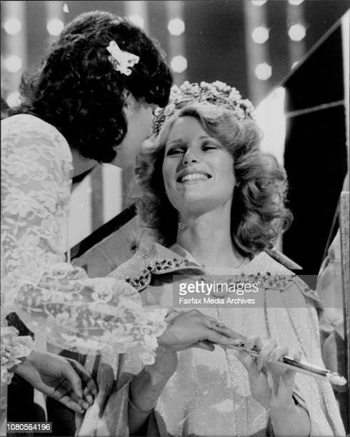 Miss aust 1977 Arancene Mavas of WA Kisses and hands ***** to New Miss aust 1978 Gloria Krope of Vict October 26 1977