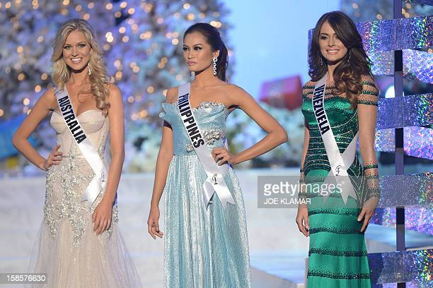 Miss Australia Renae Ayris Miss Philippines Janine Tugonon and Miss Venezuela Irene Sofia Esser Quintero stand on stage during the 2012 Miss Universe...