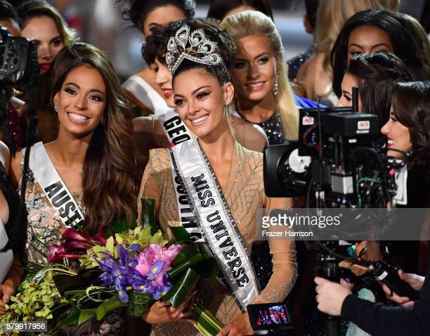 Miss Austria 2017 Celine Schrenk and Miss Belgium 2017 Liesbeth Claus appear onstage with Miss South Africa 2017 DemiLeigh NelPeters after she is...