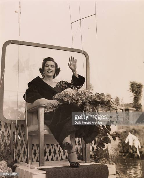 Miss Avis Scott 1954 Miss Avis Scott the Television guest announcer waves to the crowd from the barge on which she sailed up the canal to open The...