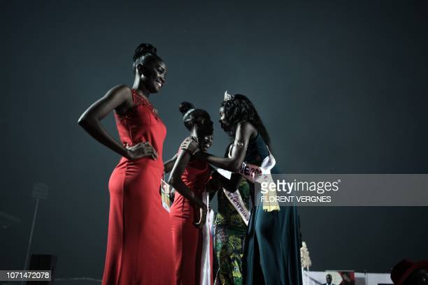 Miss Bangui 2015 congratulates the finalists of the Miss Central African Republic 2018 beauty pageant at Bangui National Stadium on December 9 2018...