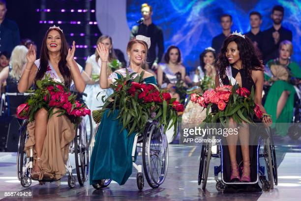 Miss Belarus Aleksandra Chichikova winner of the Miss Wheelchair World contest beauty pageant first runnerup Lebohang Monyatsi from South Africa and...