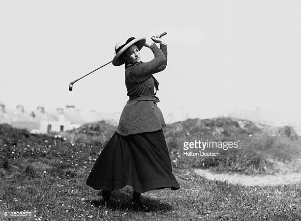 Miss Boyd tees off at a golf course in Portrush