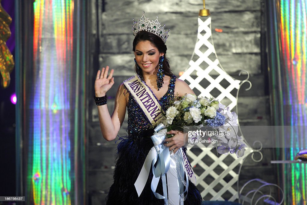 Miss Brazil, Marcelo Ohio waves after being crowned as the winner during the transgender Miss International Queen 2013 at Tiffany's Show theatre in Pattaya city. Twenty-five contestants from 17 countries are participating in the event, which is endowed with prize money of 300,000 Thai baht (10,000 US dollars), a crown with real gems and a free surgery at a plastic surgery clinic in Bangkok..