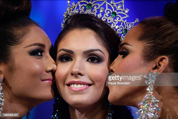 Miss Brazil Marcelo Ohio winner of the Miss International Queen 2013 beauty pageant is kissed by runner up Miss USA Shantell D'Marco from Orlando...