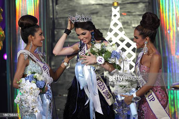 Miss Brazil Marcelo Ohio winner of the Miss International Queen 2013 transgender beauty pageant stands with runner up Miss USA Shantell D'Marco and...