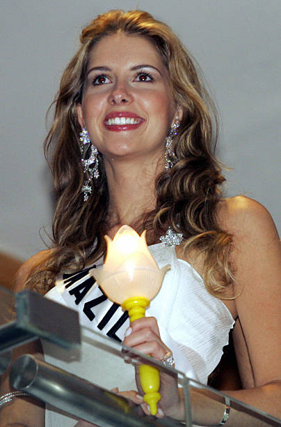 Miss Brazil Universe 2005 Crina Beduschi holds a candle during a function for AIDS victims in Bangkok 16 May 2005 The 54th annual Miss Universe...