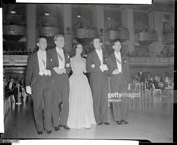 Miss Brenda Frazier beautiful daughter of Mrs Frederick N Watris with four Stalwart escorts who served as her prancing steeds during the coach...