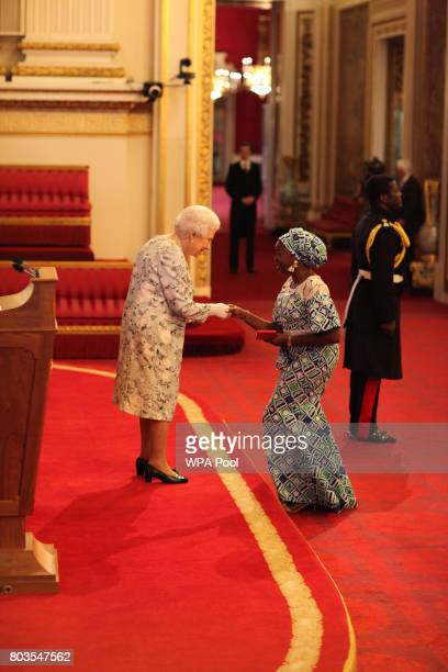 Miss Bukola Bolarinwa from Nigeria receives a Queen's Young Leaders Award for 2017 from Queen Elizabeth II at the 2017 Queen's Young Leaders Awards...