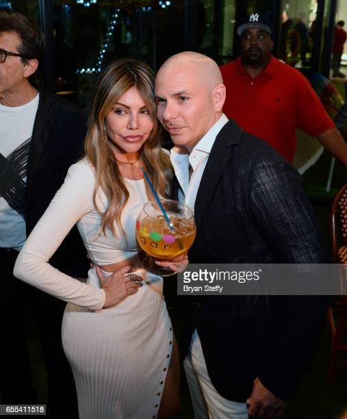 Miss BumBum 2017 Liziane Gutierrez and rapper Pitbull appear at the Sugar Factory American Brasserie at the Fashion Show mall to announce Pitbull's...