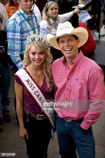 Miss Canada International Alesia Fieldberg and Stampede announcer Dave Kelly are viewed together in this 2008 Calgary Canada summer festival photo...