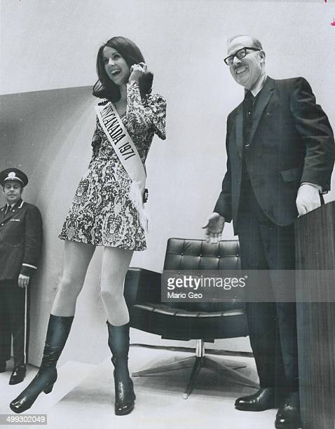 Miss Canada meets the Mayor Wearing a miniskirt this year's Miss Canada Carol Commisso 18 stands beside Toronto Mayor William Dennison at City Hall...