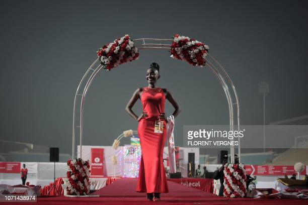 A Miss Central African Republic 2018 contestant parades in an evening dress during the beauty pageant in Bangui on December 09 2018 The Miss Central...