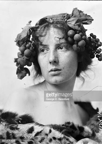 Miss Chatty Wake of Knightsbridge London wearing a grapevine headdress and fur MayJune 1902