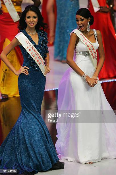Miss China PR Zi Lin Zhang and Miss Dominican Republic Ada Aimee De La Cruz stand on stage at the dress rehearsal of the 57th Miss World final...