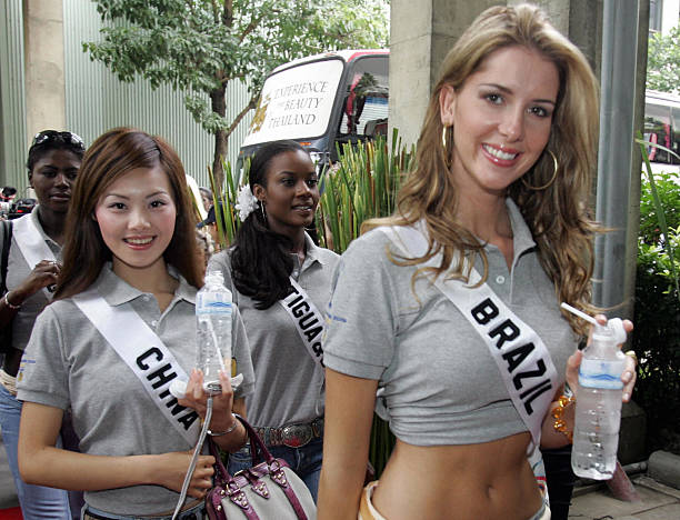 Miss China Siyuan Tao walks with Miss Brazil Crina Beduschi while visiting Singha Beer factory during a Miss Universe promotional event in Pathum...
