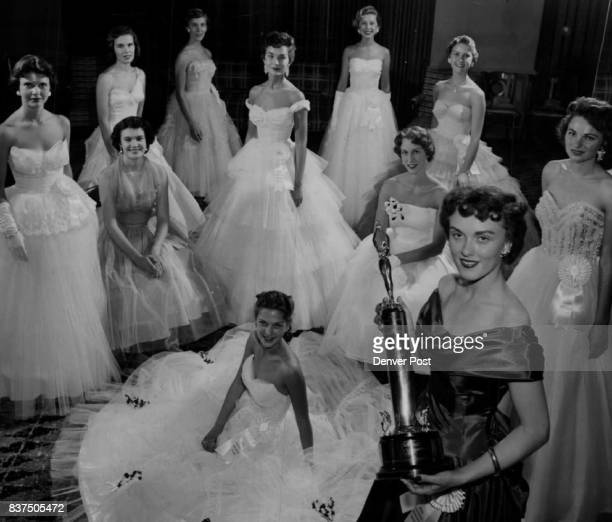 Miss Colorado candidates arrayed in stately finery for their meeting with press photographers at the Cosmopolitan hotel warm up their smiles for...
