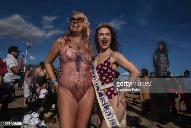 Miss Coney Island stands with a friend after participating in the annual Polar Bear Plunge on New Year's Day in Coney Island on January 1 2019 in the...