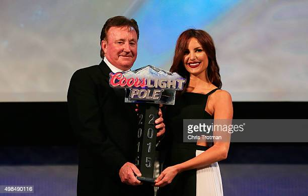 Miss Coors Light Amanda Mertz presents team owner Richard Childress with the 2015 Coor's Light Pole Award during the NASCAR Camping World Truck...