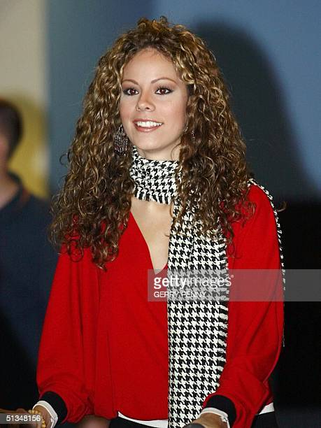 Miss Costa Rica Rico Casandra Polo Barrios smiles at the crowd upon her arrival at Gatwick Airport 24 November 2002 Miss World contestants arrived in...