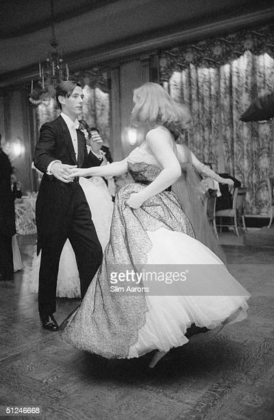 1955 Miss Daphne Battine and the Honourable Charles Wilson at the Cygnet's ball the annual dance of a fashionable finishing school Claridge's Hotel...