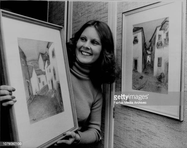 Miss Diane Bruder of Strathfield admires some of the paintings by artist Unk White which are part of an exhibition at Proude Art Gallery cnr King and...