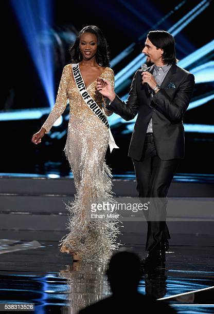 Miss District of Columbia USA 2016 Deshauna Barber walks onstage while singer Kevin Richardson of the Backstreet Boys performs during the 2016 Miss...