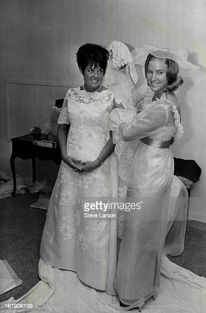 AUG 27 1967 AUG 31 1967 SEP 3 1967 Miss Doris Bell Hughes right helps Miss Betty Jane McCullough prepare for walk down aisle to become Mrs Adolph...