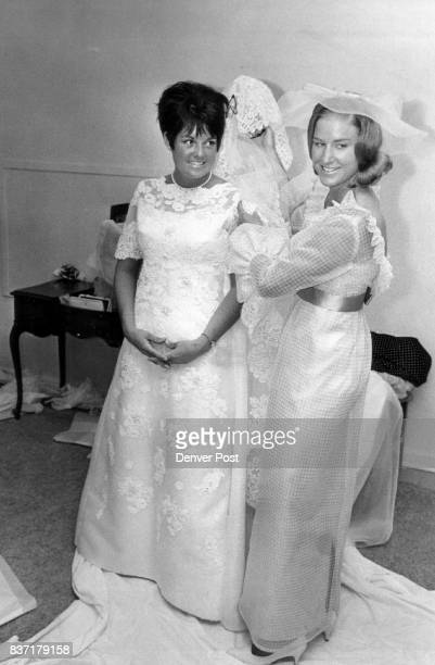 Miss Doris Bell Hughes right helps Miss Betty Jane McCullough prepare for walk down aisle to become Mrs Adolph Coors IV Credit Denver Post