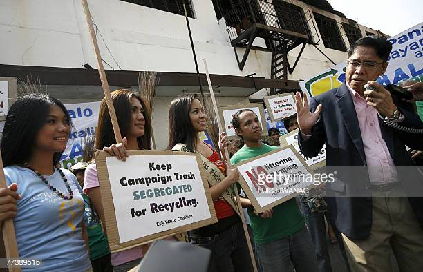 Miss Earth 2007 Philippines finalists listen to Commission on Elections commisioner Rene Sarmiento as they join the EcoWaste Coalition in a campaign...